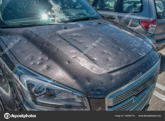 depositphotos_158360778-stock-photo-hail-damage-to-car%5B1%5D.jpg